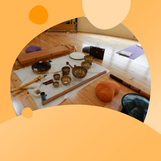Collection of singing bowls, bolsters, mats in preparation.